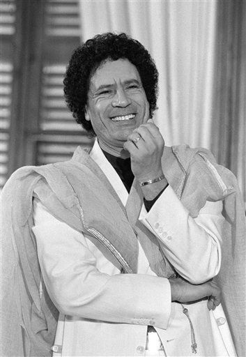 "<div class=""meta ""><span class=""caption-text "">Libyan leader Moammar al-Gaddafi shares a good laugh with newsmen during his press conference at Palma de Mallorca in Spain, Thursday, Dec. 20, 1984.  (AP Photo/ Mollard)</span></div>"