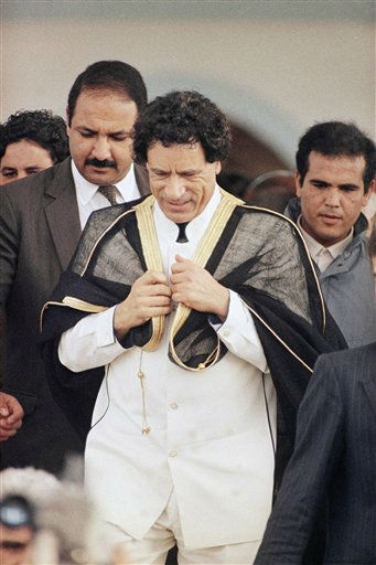 Libyan leader Moammar al-Gadhafi coming out of Tunis mosque, Friday, Feb. 5, 1988 surrounded by security agents.  <span class=meta>(AP Photo)</span>