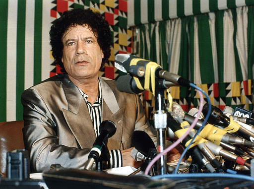"<div class=""meta ""><span class=""caption-text "">Libyan leader Moammar Gadhafi is seen here at a press conference in Tripoli, Libya, Aug. 21, 1990. (AP Photo/ AXEL SHULZ-EPPERS)</span></div>"