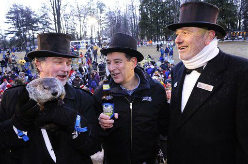 In this photo released by Samuel Adams, Samuel Adams founder and brewer, Jim Koch, center, rejoices with onlookers and toasts Punxsutawney Phil&#39;s prediction of an early spring with a bottle of spring seasonal Noble Pils, Groundhog Day&#39;s official beer, Wednesday, Feb. 2, 2011, in Punxsutawney, Pa.  <span class=meta>(AP Photo&#47; John Heller)</span>
