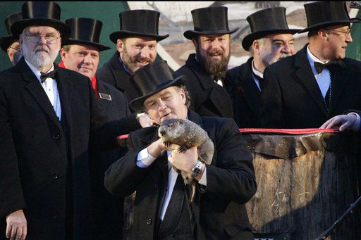 Groundhog Club handler John Griffiths holds Punxsutawney Phil, the weather prognosticating groundhog, during the 126th celebration of Groundhog Day on Gobbler&#39;s Knob in Punxsutawney, Pa. Thursday, Feb. 2, 2012. Phil saw his shadow, forecasting six more weeks of winter weather.  <span class=meta>(AP Photo&#47; Gene J. Puskar)</span>