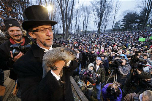 Groundhog Club handler Ron Ploucha holds Punxsutawney Phil, the weather prognosticating groundhog, during the 126th celebration of Groundhog Day on Gobbler&#39;s Knob in Punxsutawney, Pa. Thursday, Feb. 2, 2012. Phil saw his shadow, forecasting six more weeks of winter weather.  <span class=meta>(AP Photo&#47; Gene J. Puskar)</span>