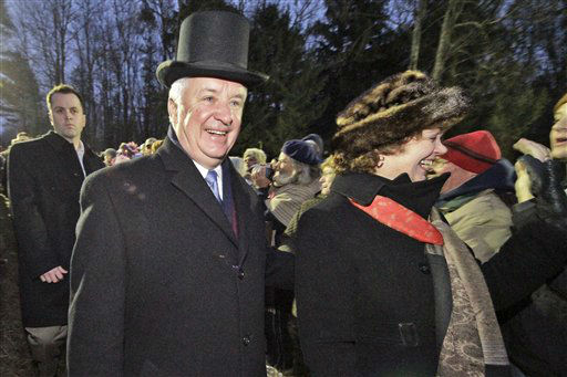 "<div class=""meta ""><span class=""caption-text "">Pennsylvania Governor Tom Corbett, left, and his wife Susan arrive on Gobbler's Knob during the 126th celebration of Groundhog Day on Thursday, Feb. 2, 2012. Weather prognosticating groundhog Punxsutawney Phil saw his shadow, forecasting six more weeks of winter weather.  (AP Photo/ Gene J. Puskar)</span></div>"