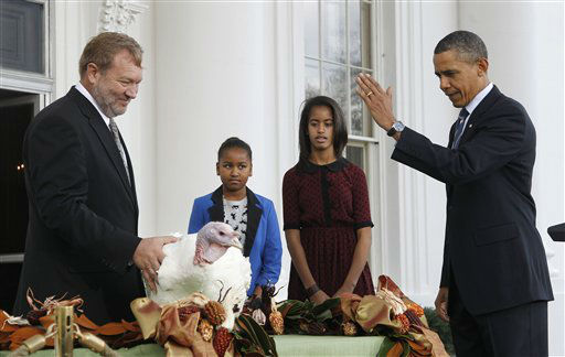 President Barack Obama, with daughters Sasha and Malia, pardons Liberty, a 19-week old, 45-pound turkey, on the occasion of Thanksgiving, Wednesday, Nov. 23, 2011, on the North Portico of  the White House in Washington. At left is National Turkey Federation Chairman Richard Huisinga. <span class=meta>(AP Photo&#47; Pablo Martinez Monsivais)</span>