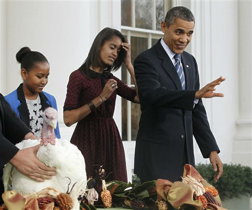 President Barack Obama stands with daughters Sasha and Malia after pardoning Liberty, a 19-week old, 45-pound turkey, on the occasion of Thanksgiving, Wednesday, Nov. 23, 2011,  on the North Portico of  the White House in Washington.  <span class=meta>(AP Photo&#47; Pablo Martinez Monsivais)</span>