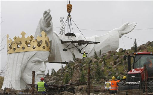 Workers raise the shoulders and arms of a statue of Jesus before placing them onto the figure&#39;s body, in Swiebodzin, Poland, on Saturday Nov. 6, 2010.  <span class=meta>(AP Photo&#47; Czarek Sokolowski)</span>