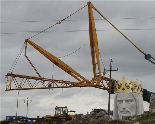 Workers struggling against wind to assemble a crane to lift the 32-ton head and shoulders to top a giant concrete and metal statue of Jesus in Swiebodzin, western Poland, Friday, Nov.5, 2010.  <span class=meta>(AP Photo&#47; Czarek Sokolowski)</span>