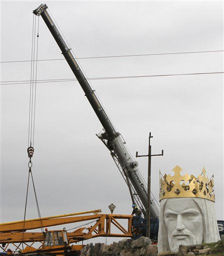 Workers struggling against wind to assemble a crane that to lift the 32-ton head and shoulders to top a giant concrete and metal statue of Jesus in Swiebodzin, western Poland, Friday, Nov.5, 2010. <span class=meta>(AP Photo&#47; Czarek Sokolowski)</span>