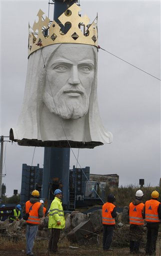 Workers raise the crowned head of a statue of Jesus before placing it slowly onto the figure&#39;s body, in Swiebodzin, Poland, on Saturday Nov. 6, 2010.  <span class=meta>(AP Photo&#47; Czarek Sokolowski)</span>