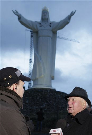 Priest Sylwester Zawadzki speaks to the media in front of a giant statue of Jesus Christ in Swiebodzin, Poland, on Saturday Nov. 6, 2010.  <span class=meta>(AP Photo&#47; Czarek Sokolowski)</span>
