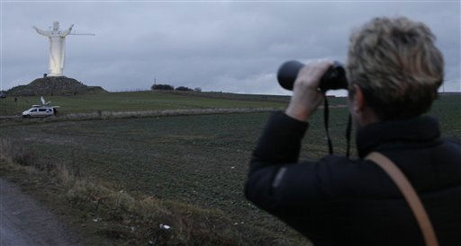 A woman looks through binoculars at a new monument to Jesus in Swiebodzin, Poland, on Saturday Nov. 6, 2010.  <span class=meta>(AP Photo&#47; Czarek Sokolowski)</span>