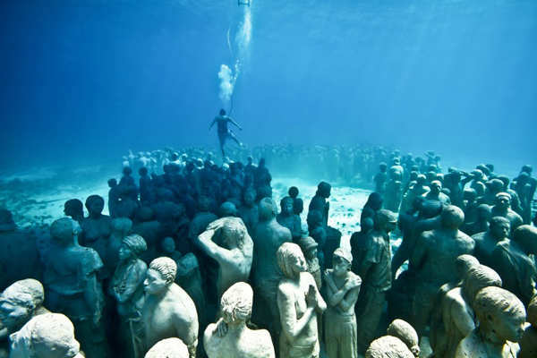"<div class=""meta image-caption""><div class=""origin-logo origin-image ""><span></span></div><span class=""caption-text"">Jason deCaires Taylor combined 18 years of diving experience and a background in the arts to create a mesmerizing underwater sculpture garden off the coast of Grenada in the West Indies. The park, founded in 2006, is meant to show that human intervention can be ""both positive and life-encouraging."" These permanent public works serve as both an art installation and a habitat for sea creatures. Each sculpture has an oblique but thoughtful name meant to symbolize the relationship between man and nature. Sculpture pictured here: Silent Evolution. (Jason deCaires Taylor/www.jasondecairestaylor.com)</span></div>"