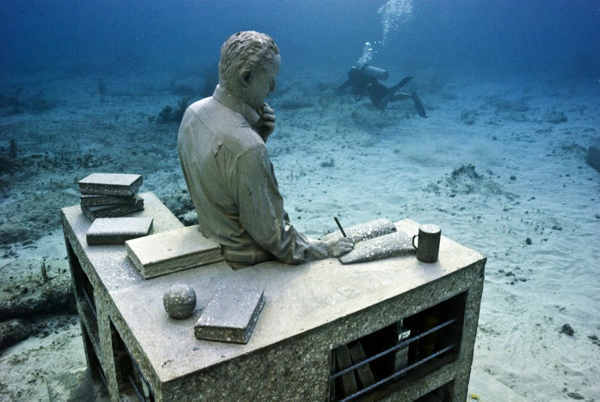 "<div class=""meta image-caption""><div class=""origin-logo origin-image ""><span></span></div><span class=""caption-text"">Jason deCaires Taylor combined 18 years of diving experience and a background in the arts to create a mesmerizing underwater sculpture garden off the coast of Grenada in the West Indies. The park, founded in 2006, is meant to show that human intervention can be ""both positive and life-encouraging."" These permanent public works serve as both an art installation and a habitat for sea creatures. Each sculpture has an oblique but thoughtful name meant to symbolize the relationship between man and nature. Sculpture pictured here: The Dream Collector. (Jason deCaires Taylor/www.jasondecairestaylor.com)</span></div>"
