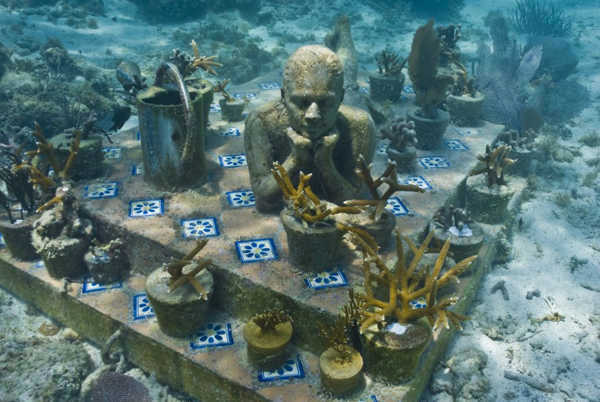 "<div class=""meta image-caption""><div class=""origin-logo origin-image ""><span></span></div><span class=""caption-text"">Jason deCaires Taylor combined 18 years of diving experience and a background in the arts to create a mesmerizing underwater sculpture garden off the coast of Grenada in the West Indies. The park, founded in 2006,is meant to show that human intervention can be ""both positive and life-encouraging."" These permanent public works serve as both an art installation and a habitat for sea creatures. Each sculpture has an oblique but thoughtful name meant to symbolize the relationship between man and nature. Sculpture pictured here: The Gardener.  (Jason deCaires Taylor/www.jasondecairestaylor.com)</span></div>"