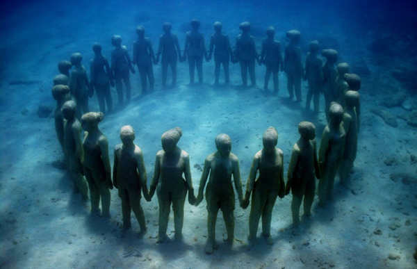 "<div class=""meta image-caption""><div class=""origin-logo origin-image ""><span></span></div><span class=""caption-text"">Jason deCaires Taylor combined 18 years of diving experience and a background in the arts to create a mesmerizing underwater sculpture garden off the coast of Grenada in the West Indies. The park, founded in 2006, is meant to show that human intervention can be ""both positive and life-encouraging."" These permanent public works serve as both an art installation and a habitat for sea creatures. Each sculpture has an oblique but thoughtful name meant to symbolize the relationship between man and nature. Sculpture pictured above: Vicissitudes. (Jason deCaires Taylor/www.jasondecairestaylor.com)</span></div>"
