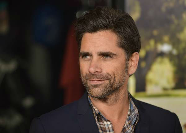 "<div class=""meta ""><span class=""caption-text "">The first lady's 50th birthday got us thinking: Who else is rocking it at the half-century mark? Pictured here: John Stamos  (AP Photo/Richard Shotwell/Invision)</span></div>"