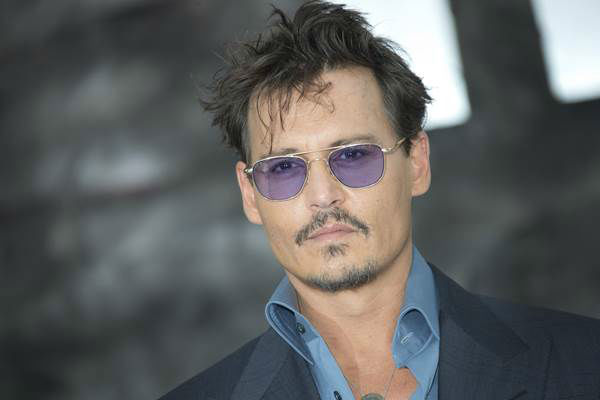 "<div class=""meta ""><span class=""caption-text "">The first lady's 50th birthday got us thinking: Who else is rocking it at the half-century mark? Pictured here: Johnny Depp  (AP Photo/Joel Ryan/Invision)</span></div>"