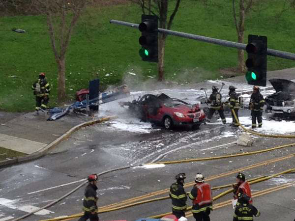 One of the first images from the scene after a KOMO TV helicopter crashed into two cars near the Seattle Space Needle, posted by a local radio presenter. <span class=meta>(Alan Budwill&#47;@AlanOnSTAR)</span>