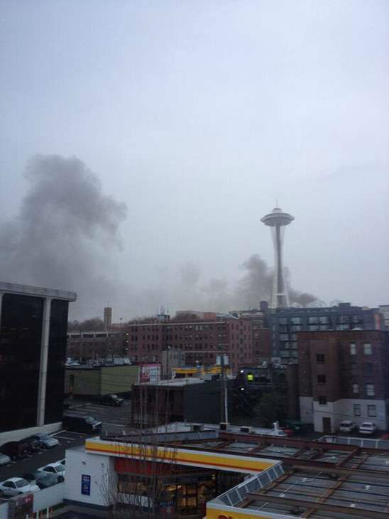 Witness Sarah Heath captured this view after a KOMO TV helicopter crashed into two cars in Seattle. <span class=meta>(Sarah Heath&#47;@nSeattleSarah)</span>