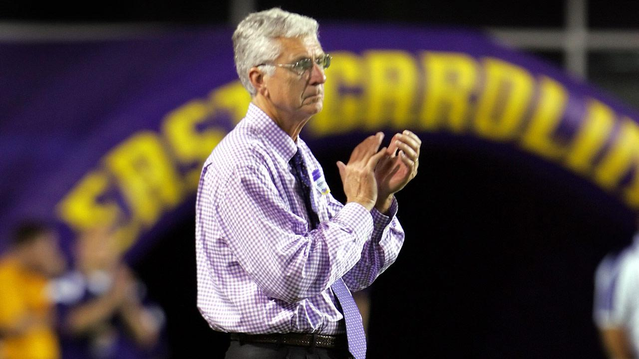 Terry Holland watches an East Carolina football game at Dowdy-Ficklen stadium in Greenville, N.C.