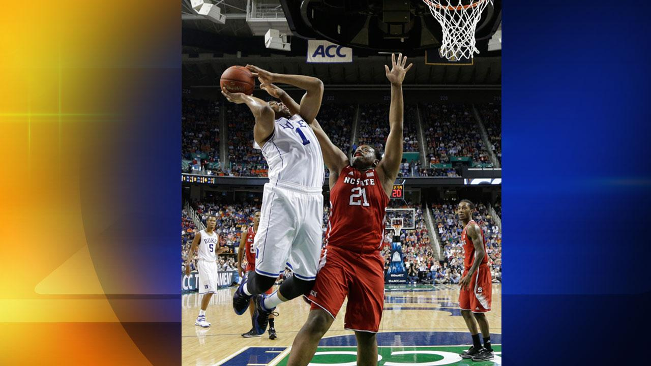 Dukes Jabari Parker (1) shoots over North Carolina States Beejay Anya (21) during the first half of an NCAA college basketball game in the semifinals of the Atlantic Coast Conference tournament in Greensboro, N.C., Saturday, March 15, 2014.