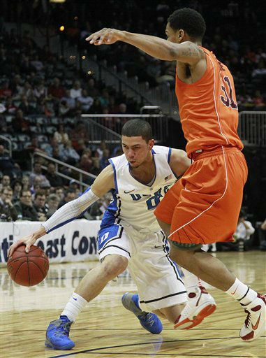 Duke guard Austin Rivers &#40;0&#41; works under pressure from Virginia Tech forward Jarell Eddie &#40;31&#41; during the first half of an NCAA college basketball game in the quarterfinals of the Atlantic Coast Conference tournament, Friday, March 9, 2012, in Atlanta. <span class=meta>(AP Photo&#47; John Bazemore)</span>