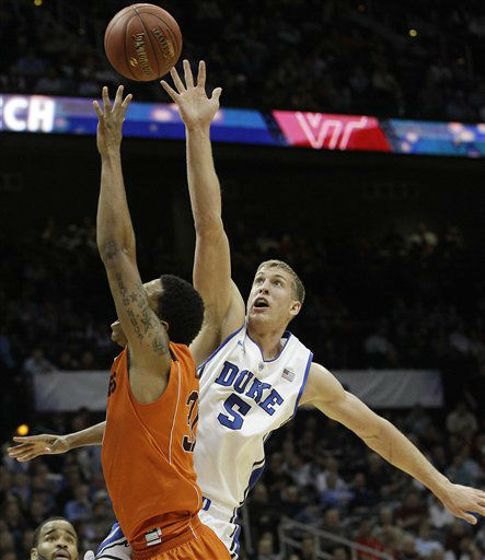 Virginia Tech forward Jarell Eddie &#40;31&#41; heads to the hoop as Duke forward Mason Plumlee &#40;5&#41; defends during the first half of an NCAA college basketball game in the quarterfinals of the Atlantic Coast Conference tournament, Friday, March 9, 2012, in Atlanta. <span class=meta>(AP Photo&#47; Chuck Burton)</span>