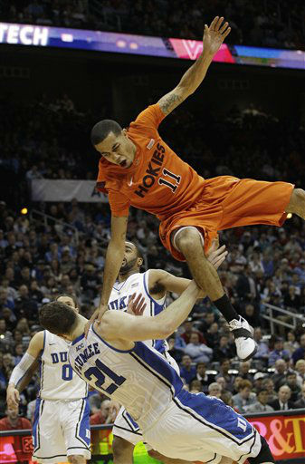 "<div class=""meta ""><span class=""caption-text "">Virginia Tech guard Erick Green (11) looses the ball as Duke forward Miles Plumlee (21) defends during the first half of an NCAA college basketball game in the quarterfinals of the Atlantic Coast Conference tournament, Friday, March 9, 2012, in Atlanta. (AP Photo/ Chuck Burton)</span></div>"