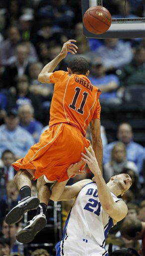 Virginia Tech guard Erick Green &#40;11&#41; loses the ball as Duke forward Miles Plumlee &#40;21&#41; defends during the first half of an NCAA college basketball game in the quarterfinals of the Atlantic Coast Conference tournament, Friday, March 9, 2012, in Atlanta.  <span class=meta>(AP Photo&#47; John Bazemore)</span>