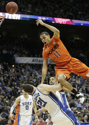 Virginia Tech guard Erick Green &#40;11&#41; loses the ball as Duke forward Miles Plumlee &#40;21&#41; defends during the first half of an NCAA college basketball game in the quarterfinals of the Atlantic Coast Conference tournament, Friday, March 9, 2012, in Atlanta.  <span class=meta>(AP Photo&#47; Chuck Burton)</span>