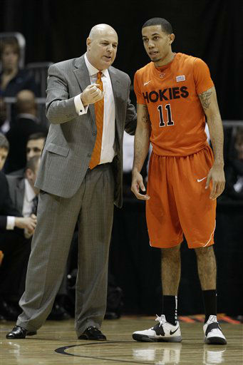 "<div class=""meta ""><span class=""caption-text "">Virginia Tech head coach Seth Greenberg speaks to Virginia Tech guard Erick Green (11) during the first half of an NCAA college basketball game against the Virginia Tech in the quarterfinals of the Atlantic Coast Conference tournament, Friday, March 9, 2012, in Atlanta.  (AP Photo/ Chuck Burton)</span></div>"