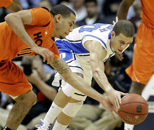 Duke guard Seth Curry &#40;30&#41; and Virginia Tech guard Erick Green &#40;11&#41; vie for a loose ball during the first half of an NCAA college basketball game in the quarterfinals of the Atlantic Coast Conference tournament, Friday, March 9, 2012, in Atlanta. <span class=meta>(AP Photo&#47; Chuck Burton)</span>