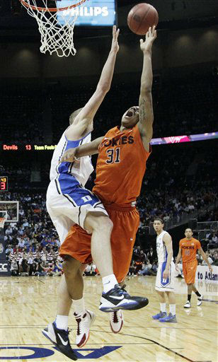 Virginia Tech forward Jarell Eddie &#40;31&#41; shoots as Duke forward Mason Plumlee &#40;5&#41; defends during the first half of an NCAA college basketball game in the quarterfinals of the Atlantic Coast Conference tournament, Friday, March 9, 2012, in Atlanta.  <span class=meta>(AP Photo&#47; Chuck Burton)</span>