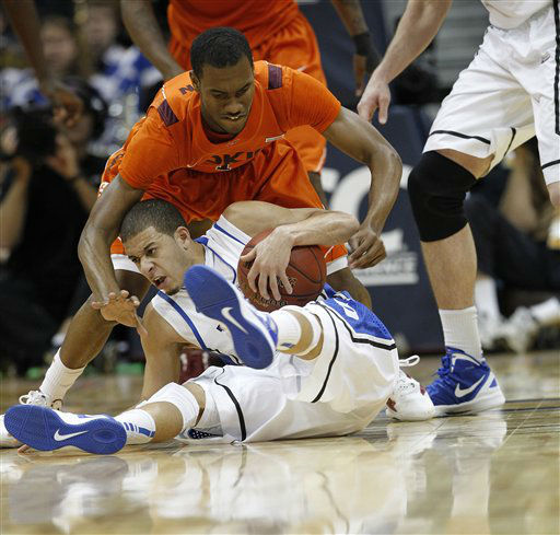 "<div class=""meta ""><span class=""caption-text "">Duke guard Seth Curry (30) and Virginia Tech guard Robert Brown (1) struggle for the ball during the second half of an NCAA college basketball game in the quarterfinals of the Atlantic Coast Conference tournament, Friday, March 9, 2012, in Atlanta.  (AP Photo/ John Bazemore)</span></div>"