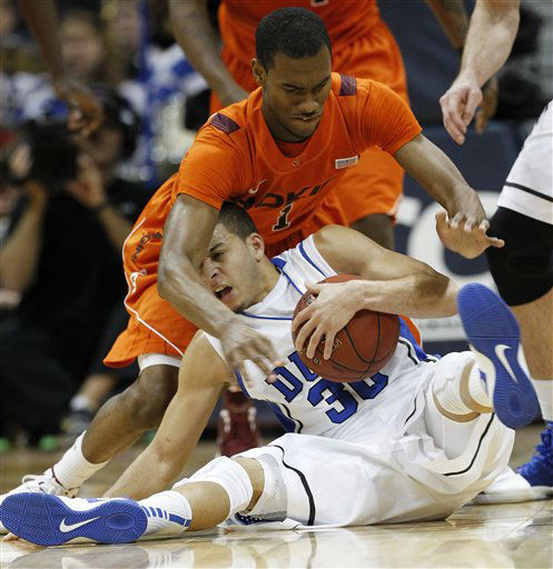 Duke guard Seth Curry &#40;30&#41; and Virginia Tech guard Robert Brown &#40;1&#41; struggle for the ball during the second half of an NCAA college basketball game in the quarterfinals of the Atlantic Coast Conference tournament, Friday, March 9, 2012, in Atlanta. <span class=meta>(AP Photo&#47; John Bazemore)</span>