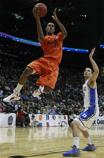 Virginia Tech guard Robert Brown &#40;1&#41; shoots as Duke guard Seth Curry &#40;30&#41; defends during the second half of an NCAA college basketball game in the quarterfinals of the Atlantic Coast Conference tournament, Friday, March 9, 2012, in Atlanta.  <span class=meta>(AP Photo&#47; John Bazemore)</span>