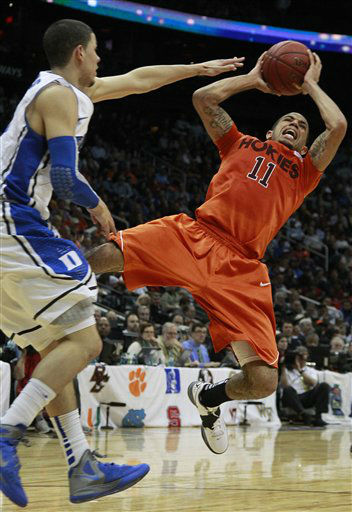 "<div class=""meta ""><span class=""caption-text "">Virginia Tech guard Erick Green (11) shoots as Duke guard Austin Rivers (0) looks on during the second half of an NCAA college basketball game in the quarterfinals of the Atlantic Coast Conference tournament, Friday, March 9, 2012, in Atlanta.  (AP Photo/ John Bazemore)</span></div>"
