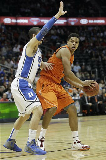 Virginia Tech guard Erick Green &#40;11&#41; looks to pass as Duke guard Seth Curry &#40;30&#41; defends during the first half of an NCAA college basketball game in the quarterfinals of the Atlantic Coast Conference tournament, Friday, March 9, 2012, in Atlanta.  <span class=meta>(AP Photo&#47; Chuck Burton)</span>