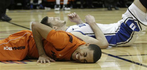 "<div class=""meta image-caption""><div class=""origin-logo origin-image ""><span></span></div><span class=""caption-text"">Virginia Tech guard Erick Green (11) reacts after colliding with Duke forward Miles Plumlee (21) defends during the first half of an NCAA college basketball game in the quarterfinals of the Atlantic Coast Conference tournament, Friday, March 9, 2012, in Atlanta. (AP Photo/ Chuck Burton)</span></div>"