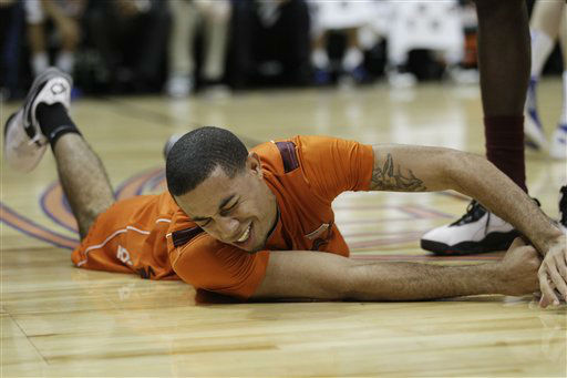 Virginia Tech guard Erick Green &#40;11&#41; reacts after colliding with Duke forward Miles Plumlee &#40;21&#41; defends during the first half of an NCAA college basketball game in the quarterfinals of the Atlantic Coast Conference tournament, Friday, March 9, 2012, in Atlanta. <span class=meta>(AP Photo&#47; Chuck Burton)</span>