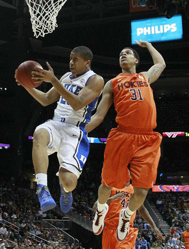 Duke guard Andre Dawkins &#40;20&#41; heads to the hoop as Virginia Tech forward Jarell Eddie &#40;31&#41; looks on during the first half of an NCAA college basketball game in the quarterfinals of the Atlantic Coast Conference tournament, Friday, March 9, 2012, in Atlanta.  <span class=meta>(AP Photo&#47; John Bazemore)</span>