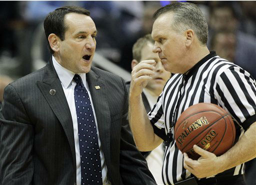 Duke head coach Mike Krzyzweski, left, speaks to an official during the first half of an NCAA college basketball game against the Virginia Tech in the quarterfinals of the Atlantic Coast Conference tournament, Friday, March 9, 2012, in Atlanta. <span class=meta>(AP Photo&#47; Chuck Burton)</span>
