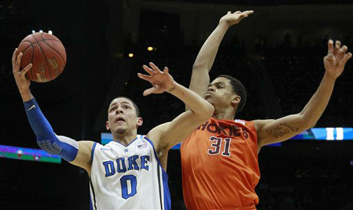 Duke guard Austin Rivers &#40;0&#41; works against Virginia Tech forward Jarell Eddie &#40;31&#41; during the first half of an NCAA college basketball game in the quarterfinals of the Atlantic Coast Conference tournament, Friday, March 9, 2012, in Atlanta.  <span class=meta>(AP Photo&#47; John Bazemore)</span>