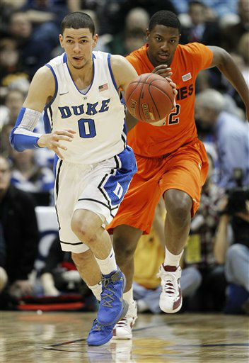 "<div class=""meta ""><span class=""caption-text "">Duke guard Austin Rivers (0) moves the ball upcourt as Virginia Tech forward C.J. Barksdale gives chase during the first half of an NCAA college basketball game in the quarterfinals of the Atlantic Coast Conference tournament, Friday, March 9, 2012, in Atlanta.  (AP Photo/ John Bazemore)</span></div>"