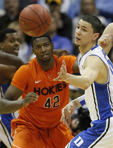 Duke guard Austin Rivers &#40;0&#41; and Virginia Tech forward C.J. Barksdale &#40;42&#41; vie for a loose ball during the first half of an NCAA college basketball game in the quarterfinals of the Atlantic Coast Conference tournament, Friday, March 9, 2012, in Atlanta.  <span class=meta>(AP Photo&#47; John Bazemore)</span>