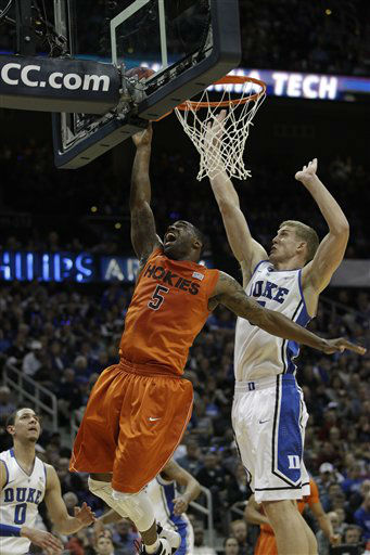 Virginia Tech guard Dorenzo Hudson &#40;5&#41; shoots and Duke forward Mason Plumlee &#40;5&#41; defends during the first half of an NCAA college basketball game in the quarterfinals of the Atlantic Coast Conference tournament, Friday, March 9, 2012, in Atlanta.  <span class=meta>(AP Photo&#47; Chuck Burton)</span>