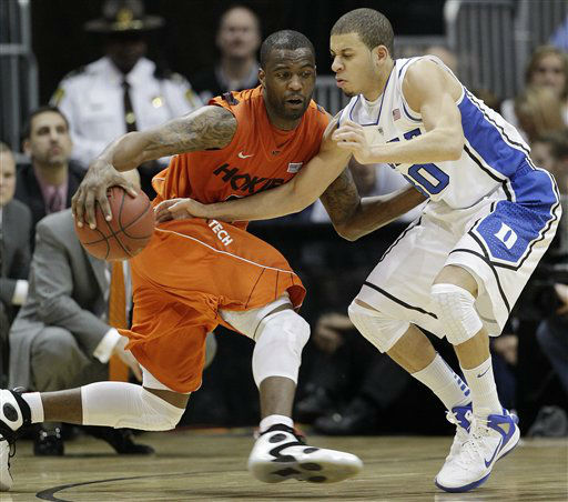 "<div class=""meta image-caption""><div class=""origin-logo origin-image ""><span></span></div><span class=""caption-text"">Virginia Tech guard Dorenzo Hudson (5) works against Duke guard Seth Curry (30) during the second half of an NCAA college basketball game in the quarterfinals of the Atlantic Coast Conference tournament, Friday, March 9, 2012, in Atlanta.  (AP Photo/ Chuck Burton)</span></div>"