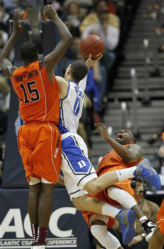 "<div class=""meta ""><span class=""caption-text "">Duke guard Austin Rivers (0) goes to the hoop under pressure from Virginia Tech guard Dorenzo Hudson (5) and Virginia Tech forward Dorian Finney-Smith, right, during the second half of an NCAA college basketball game in the quarterfinals of the Atlantic Coast Conference tournament, Friday, March 9, 2012, in Atlanta.  (AP Photo/ John Bazemore)</span></div>"