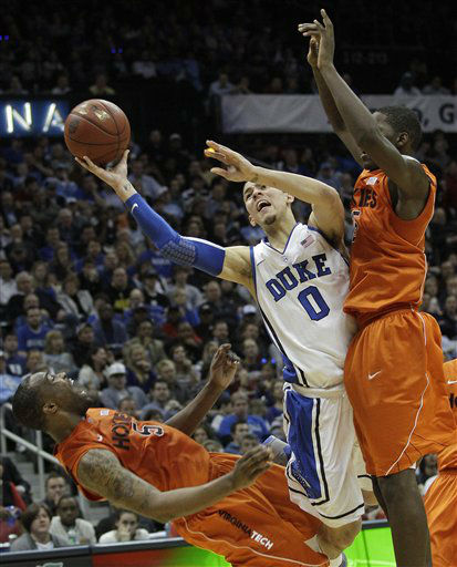 "<div class=""meta ""><span class=""caption-text "">Duke guard Austin Rivers (0) goes to the hoop under pressure from Virginia Tech guard Dorenzo Hudson (5) and forward Dorian Finney-Smith (15) during the second half of an NCAA college basketball game in the quarterfinals of the Atlantic Coast Conference tournament, Friday, March 9, 2012, in Atlanta.  (AP Photo/ Chuck Burton)</span></div>"