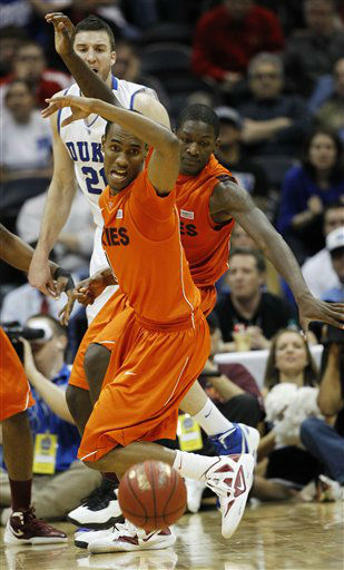 "<div class=""meta image-caption""><div class=""origin-logo origin-image ""><span></span></div><span class=""caption-text"">Virginia Tech guard Robert Brown (1) vies for a lose ball as teammate Dorian Finney-Smith (15) and Duke forward Miles Plumlee (21) look on during the second half of an NCAA college basketball game in the quarterfinals of the Atlantic Coast Conference tournament, Friday, March 9, 2012, in Atlanta. (AP Photo/ John Bazemore)</span></div>"